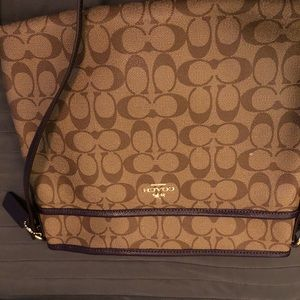 Coach Bags - Coach Large crossbody in tan with eggplant trim.